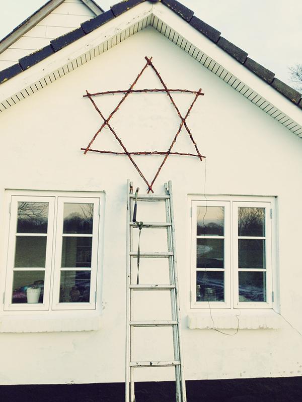 pileflet stjerne på mur